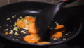 frying vegetables in a pan 49816867