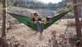mother with son in a hammock 49850074