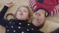 Portrait african american boy and blond caucasian girl lying on the floor on the beige fluffy carpet 49853002