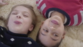 Close up portrait cute african american boy and blond caucasian girl lying on the floor on the beige 49853004