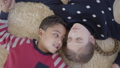 Portrait pretty african american boy and blond caucasian girl lying on the floor on the beige fluffy 49853011