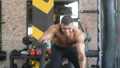 Handsome strong athletic men pumping up muscles wo 49887046