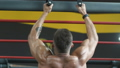Handsome strong athletic men pumping up muscles wo 49887049