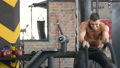 Handsome strong athletic men pumping up muscles wo 49887052