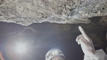 Scientists watch as water in underground caves is leaked through cracks in stones. Investigation of 49890526