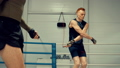 Two boxer training on skipping rope in fight club. Cardio training concept 49890679