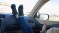 Legs young girl lying on dashboard car moving to music beat on window background 49890681