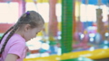 little girl jumping on trampoline 49893023