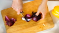 Top view of a young woman cuts the red onion. 49908660