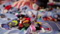 A child playing in the children's designer on the bed 49939983