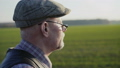 Close-up portrait of farmer looks in the distance on spring field 49948600