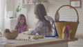 Young mother and cute daughter talking on the kitchen. Woman listening to her emotional girl, caress 49956322