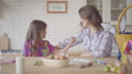 Young mother and her preteen daughter talking on the kitchen. Woman listening to her emotional girl 49956329