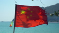 National flag of China with sea view in the background 49977900