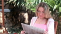 Young woman reads the newspaper 50056721