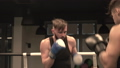 Two boxers training punches and defense 50066761