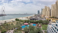 Aerial view of beach and tourists walking and sunbathing on holiday in JBR timelapse in Dubai, UAE 50079135