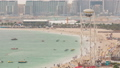 Aerial view of beach and tourists walking and sunbathing on holiday in JBR timelapse in Dubai, UAE 50079153