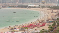Aerial view of beach and tourists walking and sunbathing on holiday in JBR timelapse in Dubai, UAE 50079155