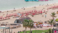 Aerial view of beach and tourists walking and sunbathing on holiday in JBR timelapse in Dubai, UAE 50079157
