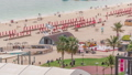 Aerial view of beach and tourists walking and sunbathing on holiday in JBR timelapse in Dubai, UAE 50079159