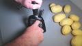 Slow motion of man's hands sharpening a kitchen knife on a sharpener 50085849