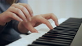 Close-up woman's hands shows how to play the piano. 50092108