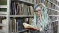 Hipster female student studiyng hard in library 50177779