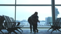 Mother embracing son and spinning around loving family waiting for flight. slow motion. 3840x2160 50274059