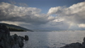 Rainbow in thunderstorm above Croatian coast, time lapse of storm clouds over Rijeka 50285105