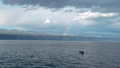 Rainbow above small fishing boat in thunderstorm 50301318