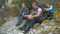 Rest and drink tea near the mountain river. Family travels. People environment by mountains, rivers 50316828