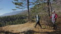 Woman do Nordic walking in nature. Girls and children use trekking sticks and nordic poles 50316855