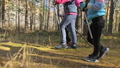 Woman do Nordic walking in nature. Girls and children use trekking sticks and nordic poles 50316857