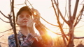 Portrait of a woman working in the garden at sunset 50324995