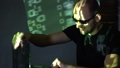 A man hacker in sunglasses in a dark room works with the program code. concept on cybercrime 50385956