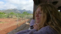 A young woman enjoying traveling on an old train, admiring beautiful tourist locations 50417908
