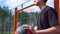 Teen listens to music on the basketball court. 50428712