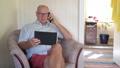 Happy Senior Man Using Digital Tablet And Phone At Home 50434097