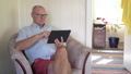 Happy Senior Man Using Digital Tablet In The Living Room 50434110