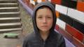 Portrait of a boy against a wall 50438889