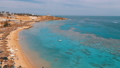 Panoramic view on Coral Beach with Umbrellas, Sunbeds and Palms at the Luxury Hotel on Red Sea at 50445567