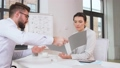 employer having interview with employee at office 50483007