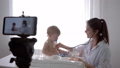 e-learning, doctor girl with stethoscope checks to heartbeat and breath of patient baby boy during 50490731