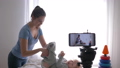 blogger profession, modern mother vlogger changes clothes of kid boy while recording training video 50490769