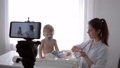 videoblog, medic female with stethoscope listens to heartbeat and breath of patient infant boy 50491335