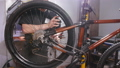 Bicycle service concept. A young man repairs and maintains a bicycle in the workshop 50581589