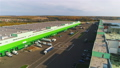 warehouse with lorries and helicopter pad bird eye view 50643000