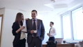 Businessman with female colleague flirts in office. 50662352