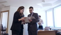 Businessmen with female colleague stands with documents in office. 50662377